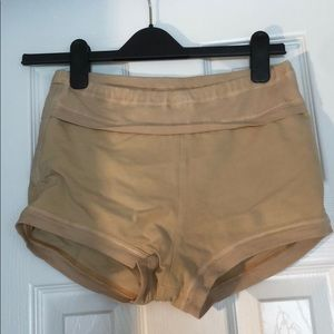 Free people movement peach colored shorts
